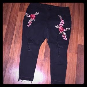 Black ripped jeans with floral embroidery